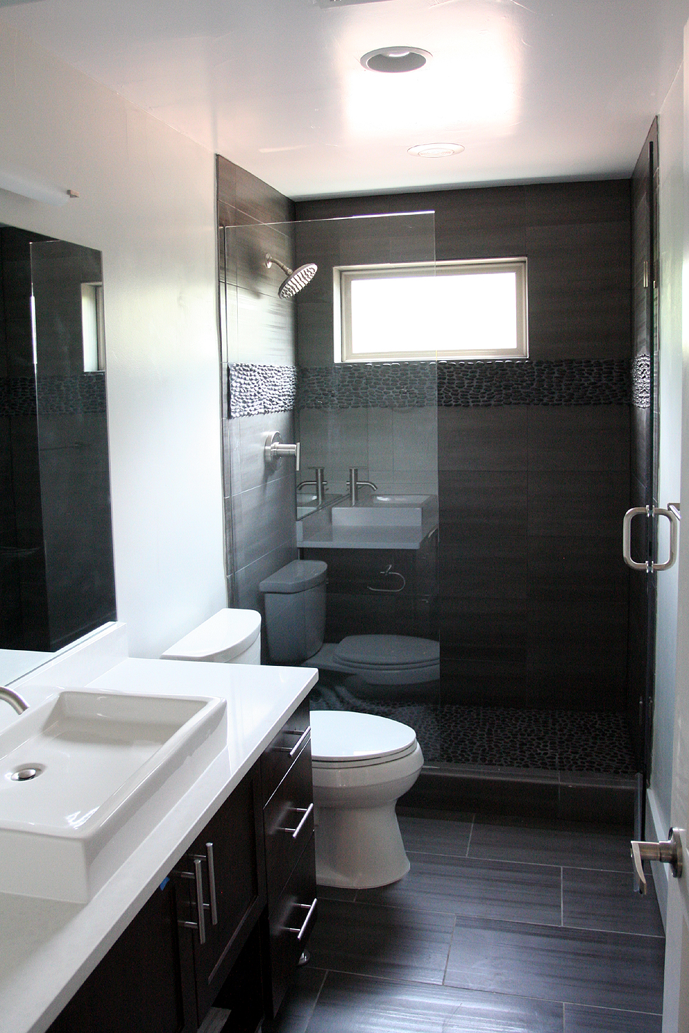 Fantastic finishes on a contemporary denver duplex for Pictures for your bathroom