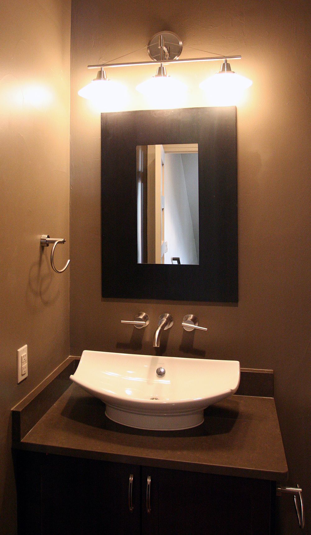 Fantastic finishes on a contemporary denver duplex - Powder room sink ideas ...